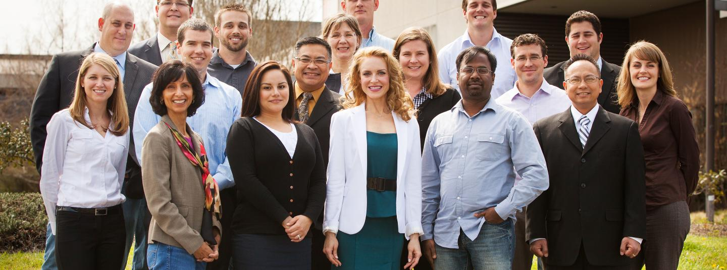 EMBA students standing in front of a building