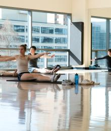 Individuals exercising in a gym