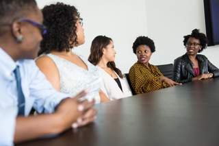 Employees sitting at a conference table