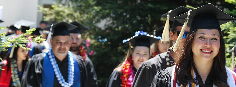 President Judy Sakaki and Lobo mascot