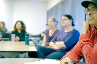 A group of students listening to a talk